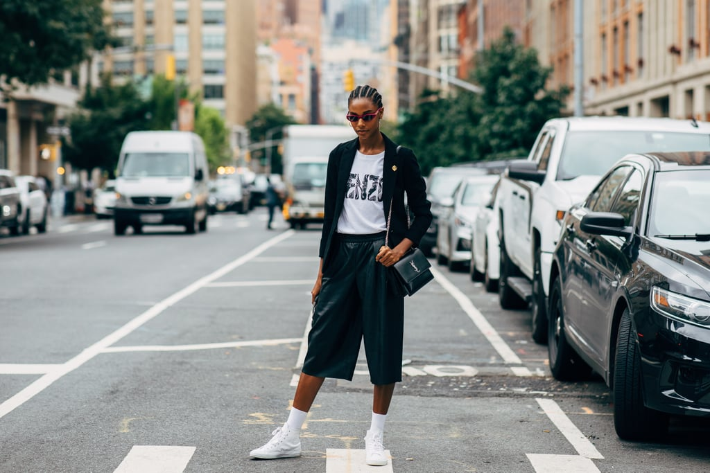 Slip into Bermuda shorts and the sneakers of your choice.