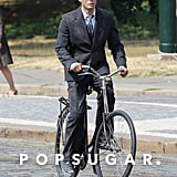 Riding a Bike in a Suit