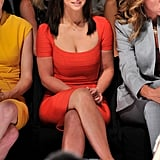 Jennifer Love Hewitt wearing an orange dress.