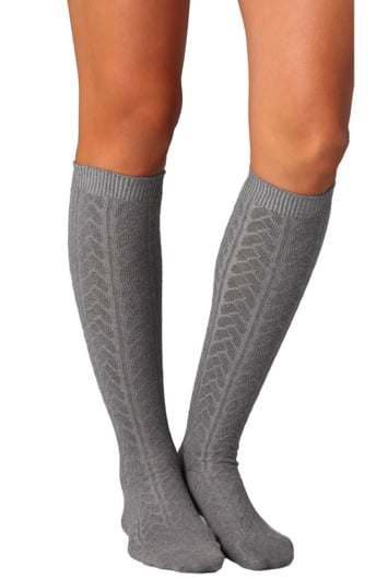 Give your boots a little more personality with just a hint of a textured knee-high sock peeking through — this Falke version ($34) is schoolgirl chic, but you can always go for a more dynamic pair, too.