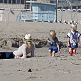 Naomi Watss laid in the sand while her sons played on the beach in Santa Monica.