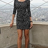 Heidi Klum showed pure sex appeal in a slinky long-sleeved Dolce & Gabbana minidress. She gave the sultry look a vintage flair with metallic-tinged pumps and a sweep of red lipstick.