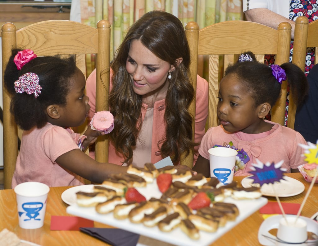 In 2016, she looked genuinely interested while speaking to these two little girls during her April visit to the Naomi Children's Hospice in England.