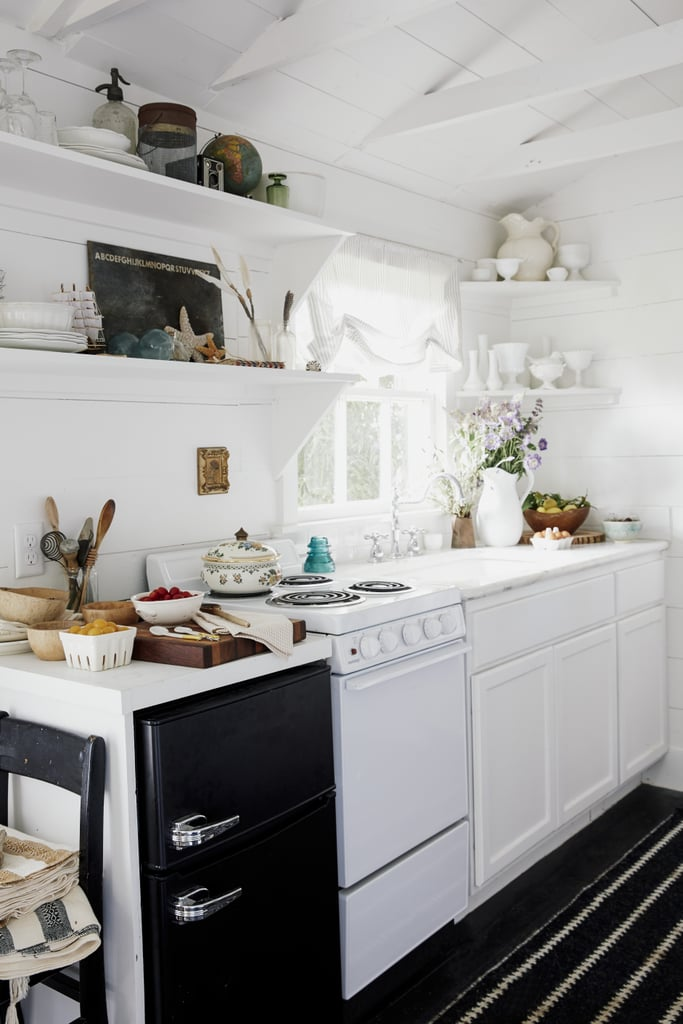 The tiny kitchen is inspired by European designs and includes a miniature stove and microwave.  Source: Cody Ulrich via Homepolish