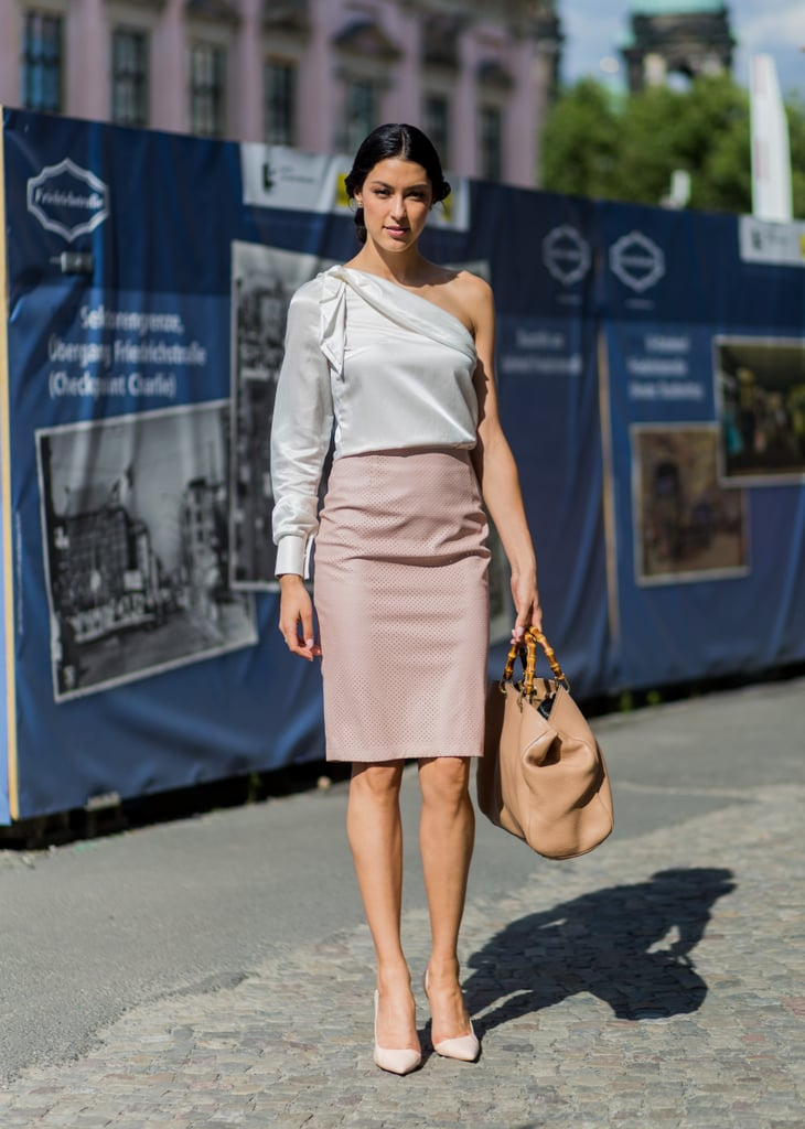 A one-shoulder blouse with a pencil skirt