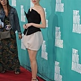 Emma Stone wore a mini dress to the MTV Movie Awards.