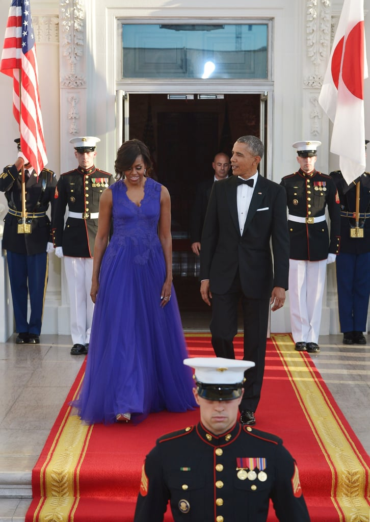 Wearing Tadashi Shoji at a state dinner with Japanese Prime Minister Shinzo Abe and his wife, Akie Abe, in 2015.
