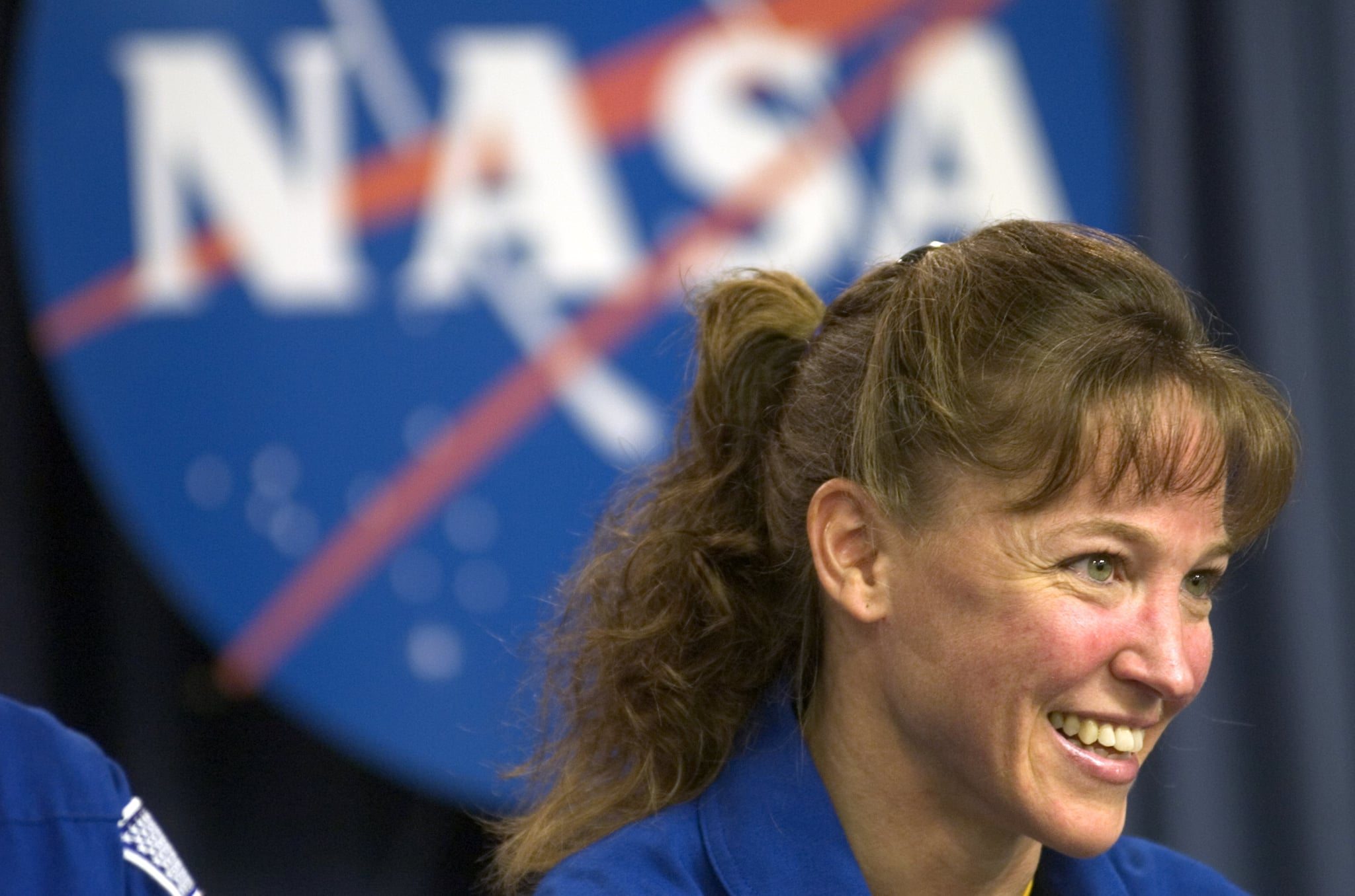 KENNEDY SPACE CENTER, FL - JULY 17:  Mission Specialist Lisa Nowak speaks at a post mission press conference July 17, 2006 at Kennedy Space Centre in Florida. Discussed was the progress the mission had made on the completion of the International Space Station.  (Photo by Philip Andrews/Getty Images)
