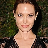 Angelina Jolie walked the red carpet with Brad Pitt by her side. Her hair was pulled back into a chic updo, and her makeup was clean and natural with an emphasis on her eyes.