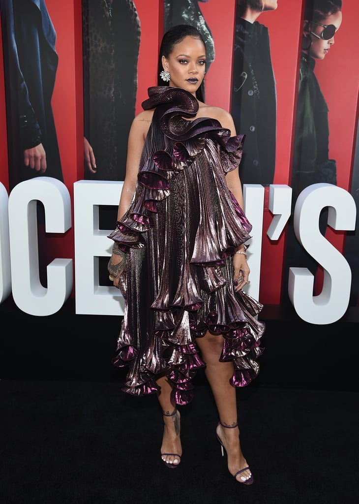 Rihanna's used to taking big fashion risks that pay off (ahem, every Met Gala ever), and the Ocean's 8 premiere was no exception.   The 30-year-old singer, entrepreneur, and now actress stepped onto the red carpet on June 5 in a ruffled one-shoulder Givenchy dress that cascaded down one side, giving a beautiful waterfall effect. She paired her unique gown with delicate strappy purple heels, a BVLGARI watch and earrings, and a matching jeweled clutch. Rihanna is radiant no matter what she wears, but the metallic tint of her dress caused her to shine so brightly at the premiere, she had to catch everyone's eye.       Related:                                                                                                           Ocean's Eight Is Already Shaping Up to Be the Most Fashionable Film of 2018