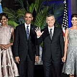 Michelle played up the silver crystals on her dress with lovely hoop earrings. She was complemented by Argentine first lady Juliana Awada, who chose a gray lace number in a similar silhouette.