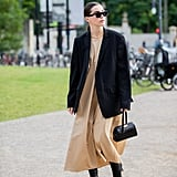 Autumn Outfit Idea: Black Blazer + Tan Dress + Leather Boots