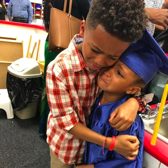 Photo of Boy Hugging His Little Sister at Pre-K Graduation
