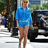 Karolina Kurkova might as well have been on a runway in a blue button-down blouse and mini denim shorts while out in NYC.