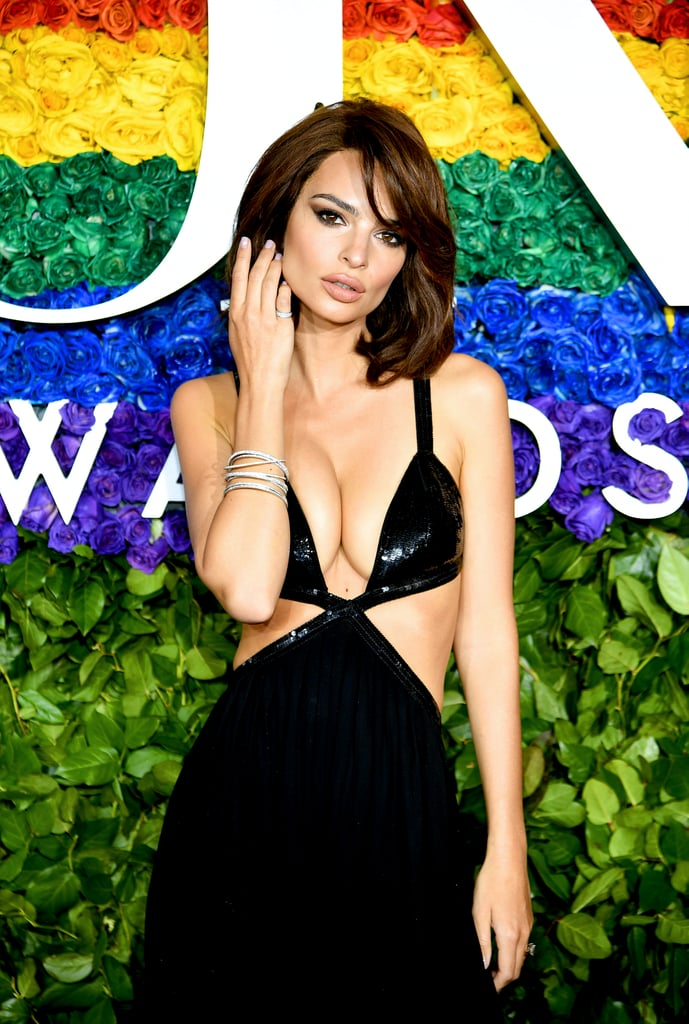 Emily Ratajkowski turned up at the 73rd annual Tony Awards, made our jaws drop because of her dress featuring a neckline that plunged down to her stomach, and gave us our new haircut inspiration, all in a mere Sunday's work.  Switching from her just-below-the-shoulder cut, the 28-year-old model graced the red carpet making a case for the layered lob with side-swept bangs. It's a style that harks back to beauty icons of '80s and the '60s, bringing to mind bombshells like Brigitte Bardot, Jean Shrimpton, and Jackie O. And of course, being Ratajkowski, she made the already sexy style even sexier.  The voluminous blowout combined with winged shadow and paled-out lips added to the overall '60s vibe in a thoroughly 2019 sort of way. Makeup artist Linda Hay used a selection of Pat McGrath Labs products including Mothership Sublime Palette (£50) to create sharp wings and Permagel Ultra Lip Pencil in Done Undone (£26) for the matte beige-pink lip.   Ratajkowski recently experimented with choppy, shorter styled wigs, perhaps practising for the real thing? She tried blonde for a day and it totally worked. Oh, and how could we forget the pastel pink hue she played with on Instagram — now that's a style we really wish she'd keep for real.  But out of all the recent hairstyles Ratajkowski's experimented with, this nostalgic bob has to be one of our favourites. And bobs are definitely are back. It's a hairstyle that, it seems, the whole of Hollywood has dabbled in recently. Selena Gomez went got the chop, for real, echoing Rachel from Friends. And how could we not mention Kaia Gerber's fresh chin-length chop? If you're not convinced that Emrata's new style is her best yet, these 10 photos will.