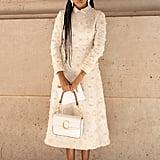 Dress down an embellished sheath with classic white kicks.