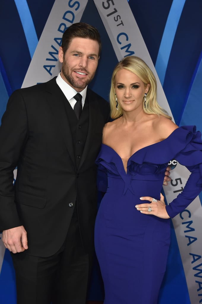 "Carrie Underwood made a stunning arrival for the CMAs in Nashville on Wednesday, and she wasn't alone: the ""Dirty Laundry"" singer was joined by her adoring husband, NHL player Mike Fisher, who cleaned up nicely in a sharp tux that complemented Carrie's low-cut cobalt blue gown. Carrie is hosting the big show for the tenth consecutive time alongside fellow country star Brad Paisley and is also nominated for female vocalist of the year, an award she's taken home four times previously. Keep reading to see photos from Carrie's big night, then look back on all the best pictures from CMAs past."