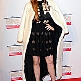 Lindsay Lohan opted for a cage cutout top and eye-catching silver shoes.