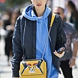 Paired with a hoodie, bomber, and statement bag, all in a complementary color scheme.