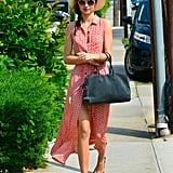 Miranda Kerr put her best Summer style forward in a printed maxi shirtdress, a Panama hat, gold Miu Miu sunglasses, and gold chain sandals in NYC.