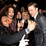 Justin Timberlake stopped to greet fans on his way to the Brit Awards.