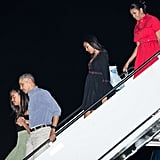 Michelle wearing a red shirtdress on her way to Hawaii.