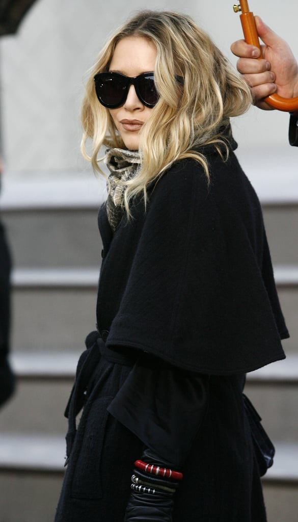 Mary-Kate attended the Fall/Winter 2010 Burberry show during London Fashion Week in a dark trench and bug-eye shades.