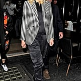 Gwen Stefani dressed in a checkered blazer for dinner in London.