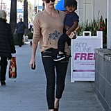 Charlize Theron carried her son, Jackson, as they made their way to Pinkberry in LA.