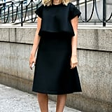All-black is all-class. To elongate your pins in a midi hemline, just add pointed pumps.