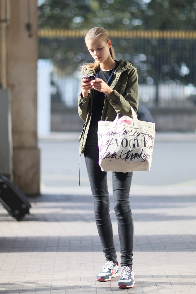 Leather leggings got athletic edge with a pair of sporty kicks.