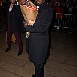 Jamie Foxx arrived carrying flowers for his daughter Corinne, who walked in the show.