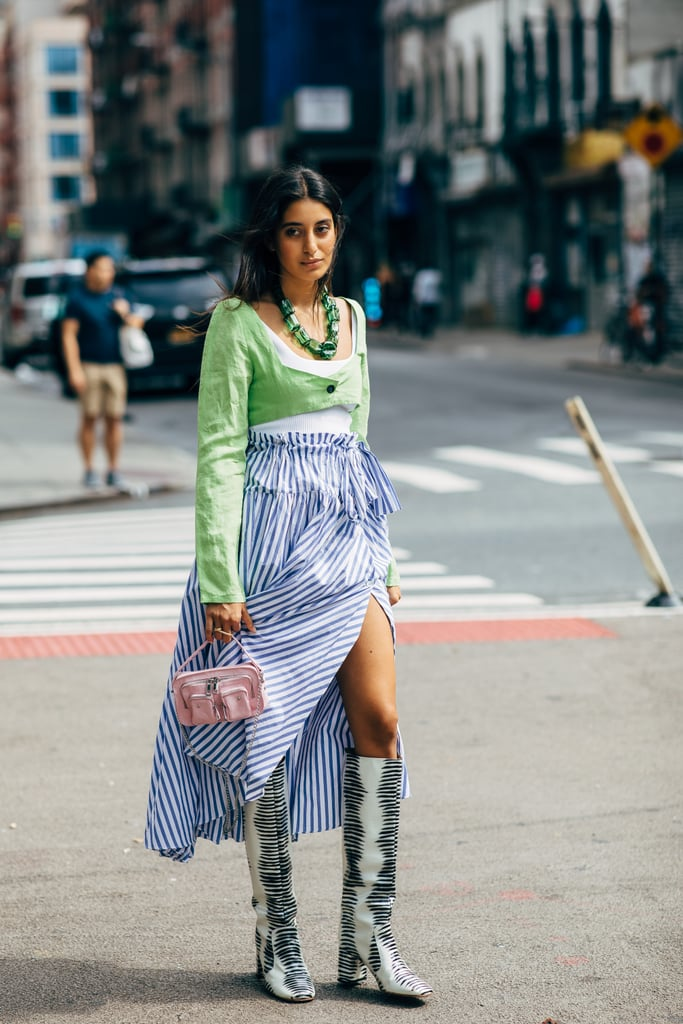 Take an inherently summery look, like blue and white stripes, and add boots to mix it up.