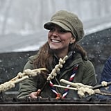 Kate Middleton smiled while she grilled by the campfire.