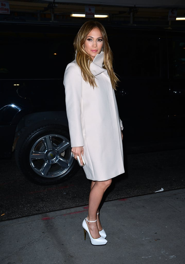 Lopez brushed off the NYC chill wearing a ladylike Lanvin coat featuring an exaggerated collar. Instead of the usual black or gray pea coat, tyou out a lighter hue, like Jennifer's off-white rendition, for a softer take on Winter.