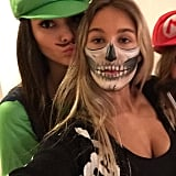 Kendall Jenner posted a pic of her Luigi costume alongside a skeletal friend.