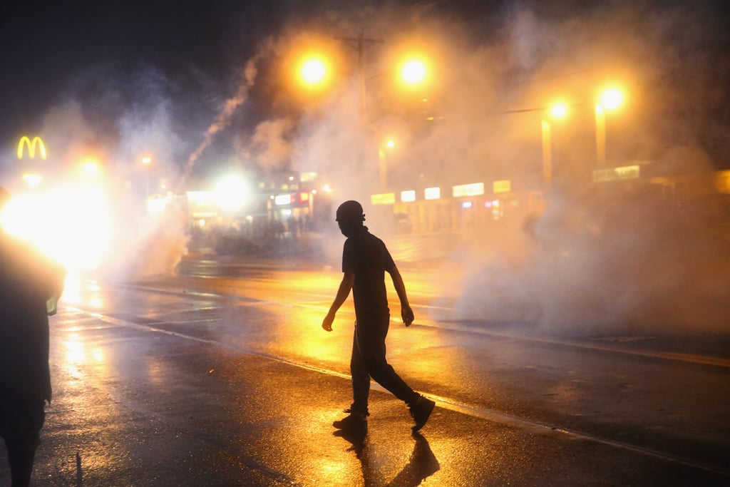 Tear gas filled the streets after demonstrators disobeyed the midnight curfew.