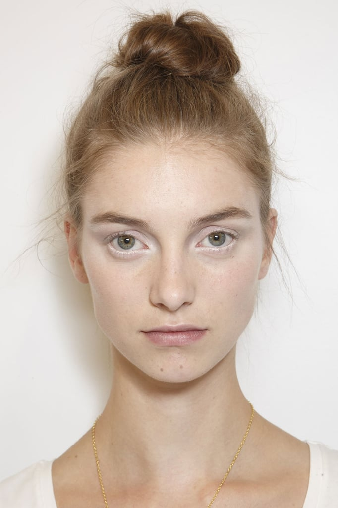 The makeup was a mix of whites and grays at Viktor & Rolf's Fall 2013 Haute Couture show, while hair was set in a tousled topknot.