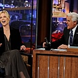 Jay Leno had Charlize in stitches.