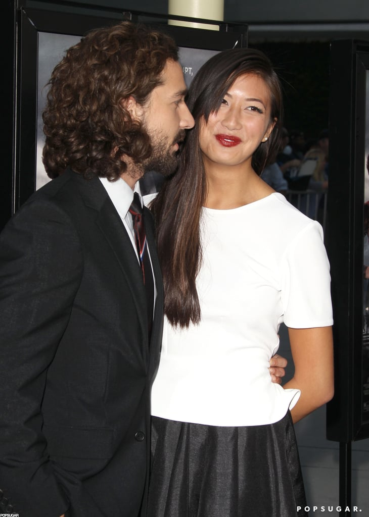 Shia LaBeouf kept girlfriend Karolyn Pho close on the red carpet.