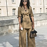 Play up curves by topping wide-leg trousers with a waist-cinching blazer or top.