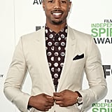 Michael adjusted his jacket on the red carpet at the Independent Spirit Awards in March 2014.