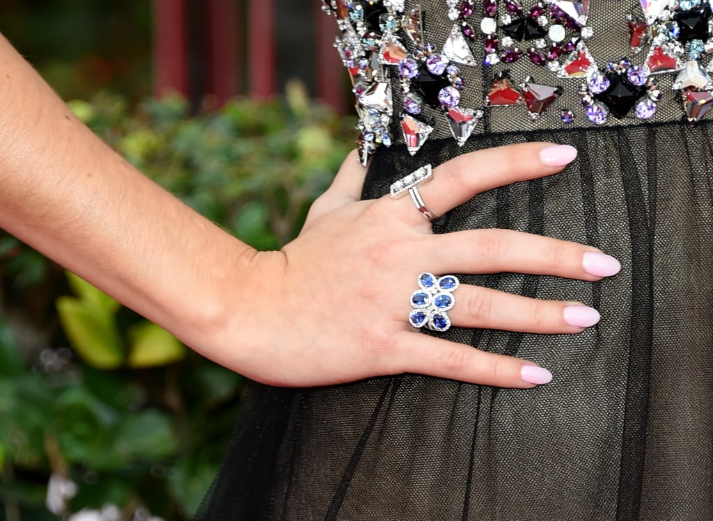 Sarah Hyland played up the gems on the bodice of her Vera Wang dress with quirky rings by Lorraine Schwartz.