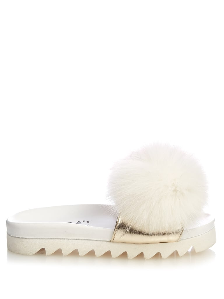 Joshua Sanders Fur-pompom platform slides ($354)