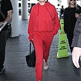 Selena Walked Through the Airport in a Sweatsuit and Heels