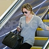Hilary Duff carried her luggage and her baby bump at LAX.