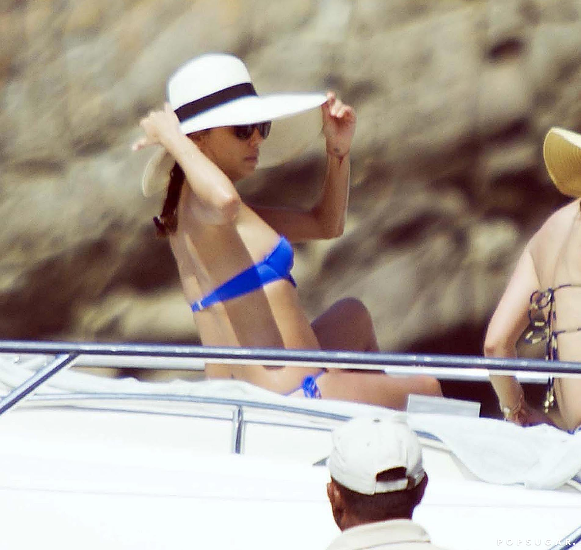 She shaded her face from the sun while lounging on a friend's yacht.