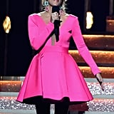 The star commanded the stage in a Stello hot pink gown and teal sparkly earrings.