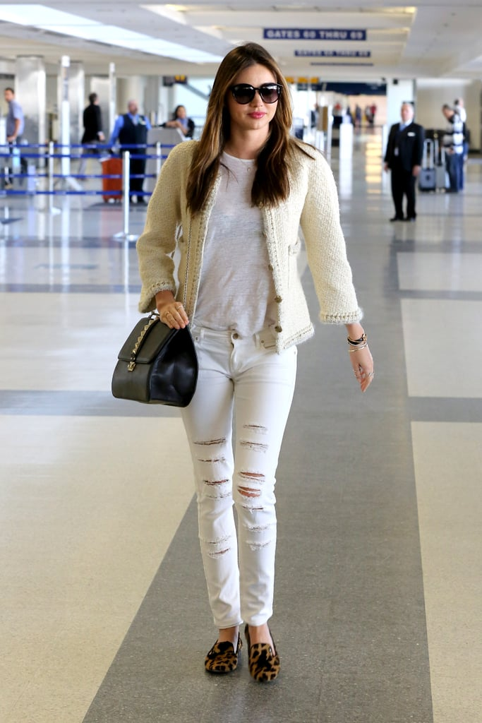 Layering nude neutrals and adding leopard loafers is a cool way to dress at the airport.