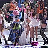 Models danced on the end of the runway at the 2011 Victoria's Secret Fashion Show.